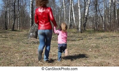 mother and daughter runs round the birch - happy mother and...