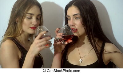 two sexual young girls get drunk and kisses in studio - two...