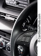 gear shift - audio control bottons on steering wheel of...