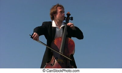 young man plays violoncello - portrait of young man plays...