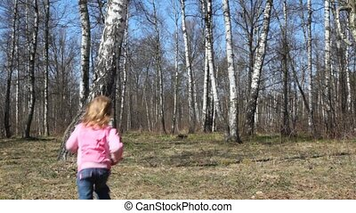 girl runs from camera to spring brich grove - little girl...