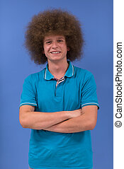 Man with funky hairstyle - portrait of a young man with a...