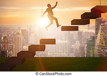 Businessman in career promotion concept with stairs