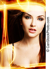 Light painting Beauty - A pretty young woman with an...