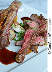 Roasted tomahawk - Closeup roasted tomahawk with special...