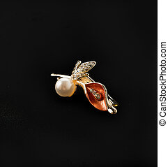 brooch on black background