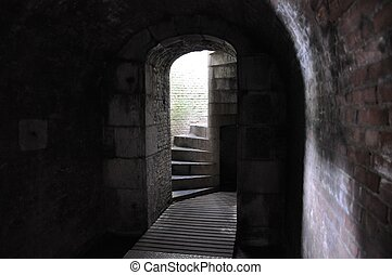 the way out - stair leading from a dark cavern up to the...