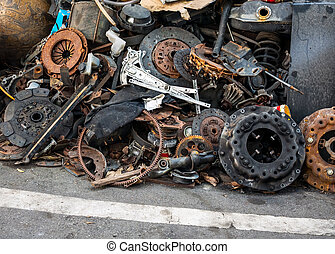 Parts pile of old cars abandoned on a rubbish heap.