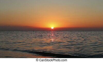Beautiful sunrise on the beach.  Costa del Sol (Coast of the Sun), Malaga in Andalusia, Spain