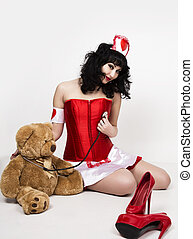 young beautiful woman dressed as nurse, medical carnival...