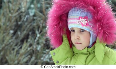 little girl in winter under snow