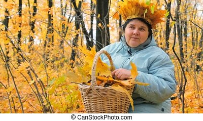 aged woman with basket in park