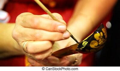 female hands holding wooden spoon and painting it - female...