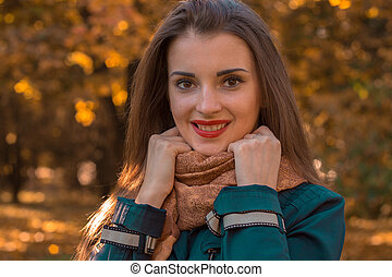 charming young girl with red lipstick on lips holding hands and smiling scarf