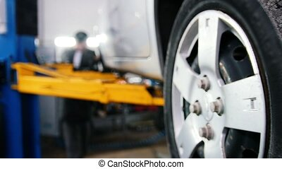 Wgite car in auto service lifting for repairing, slider,...