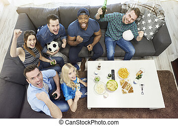All of best friends watching football match