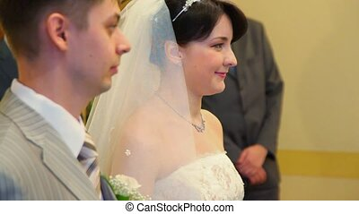 bridegroom and bride during registration in registry office,...