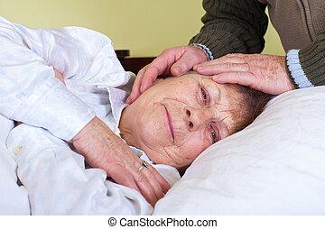 Bedriedden elderly woman - Picture of a bedridden elderly...
