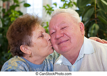 Cute senior couple kissing - Picture of a cute elderly...