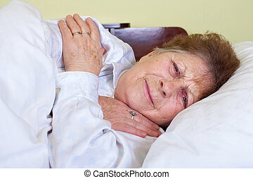 Sick old lady in bed - Picture of a sick old lady being...