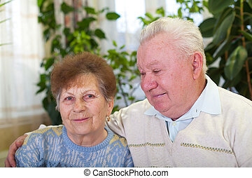 Smiling elderly couple at home - Picture of a smiling...