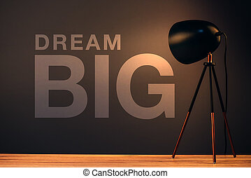 Dream big, business concept with motivational text on office...
