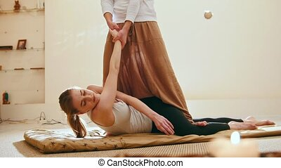 Traditional thailand massage therapy - impact on hands of caucasian female