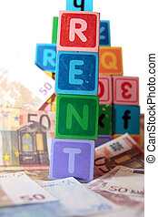 rent money in toy blocks - toy letters that spell rent with...