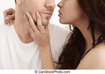 Passion between heterosexual couple in the bed