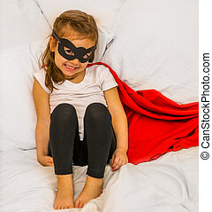 the girl super hero - girl super hero with a mask is sitting...