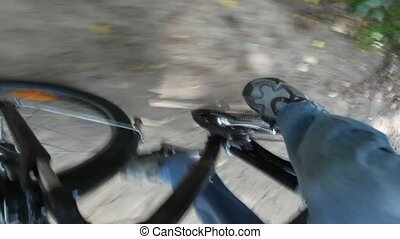 legs of man pedaling on bicycle