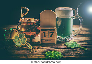 St. Patricks Day decoations with gold coins, green beer and...