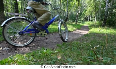 mother with son rides bikes in park - mother with her son...