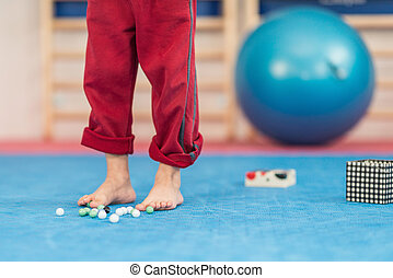 Flat feet physical therapy - Little boy picking up marbles...