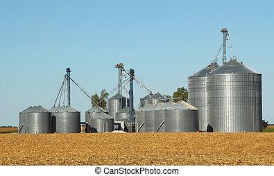 Grain Bins - Agricultural grain bins in a farm field