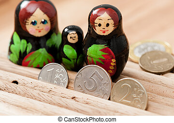 russian currency - Russian coins and russian nesting doll