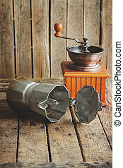 Coffee grinder, coffeepot on the burlap's napkin, wooden...
