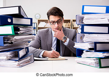 Busy businessman under stress due to excessive work