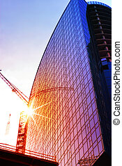 housebuilding at sunset - construction of skyscraper,...