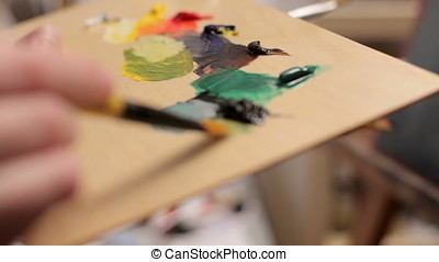 Painter Preparing Oil Colors For Canvas Painting. Art and...