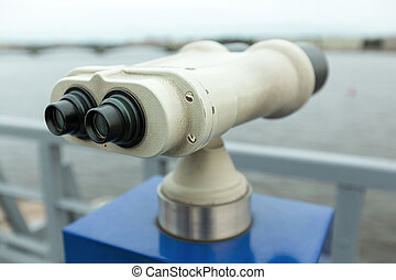 tourist binoculars at Peter-Pavel Fortress. with a view of...
