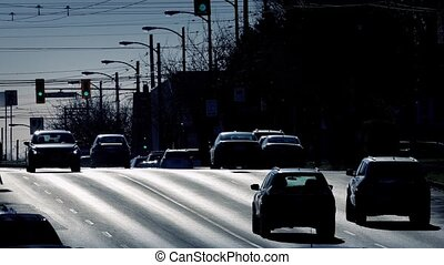 Busy City Road In Dramatic Sunlight - Cars driving on city...