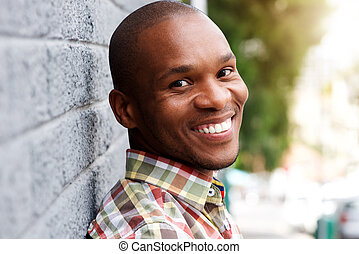 handsome young african man smiling