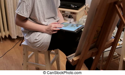Painter In Her Shop Searching The Inspiration On Web