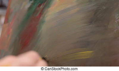 Artist Painting Abstract Lines On A Canvas