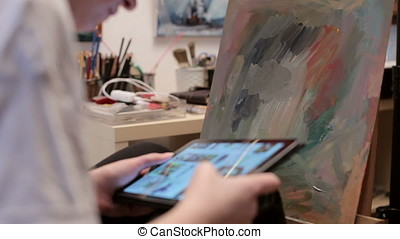 Artist Using A Digital Tablet In Her Shop