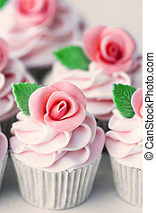 Wedding cupcakes decorated with pink sugar roses