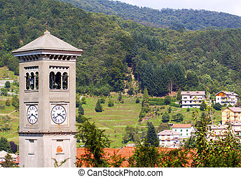 Clocktower and landscape of a little city in Italy (Masone)