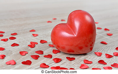 Red hearts on wooden board.