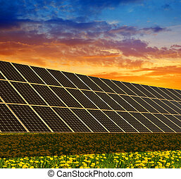 Solar power station on the spring flowering meadow at...